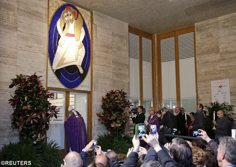 Pope Francis opening Door of Mercy at homeless shelter in Rome on Dec. 19th.