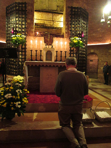 Deacon Tom Bello praying and waiting for mercy at the tomb of St. Francis of Assisi