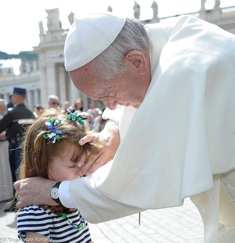 Pope Francis blessing a blind and deaf girl at his General Audience