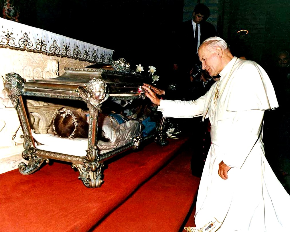 St. John Paul II venerating the sacred body of St. Maria Goretti shortly after his election as Supreme Pontiff in July 1979.