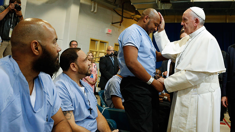 Pope Francis blesses a prisoner as he visits the Curran-Fromhold Correctional Facility in Philadelphia Sept. 27, 2015. CNS photo/Paul Haring