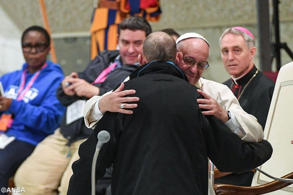 Pope Francis embraces one of 6,000 guests to the Vatican for the Jubilee for Socially Excluded Persons