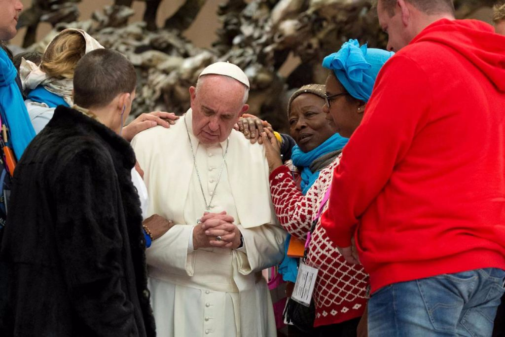Pope Francis praying with the poor and homeless guests at the Jubilee for Excluded Persons.